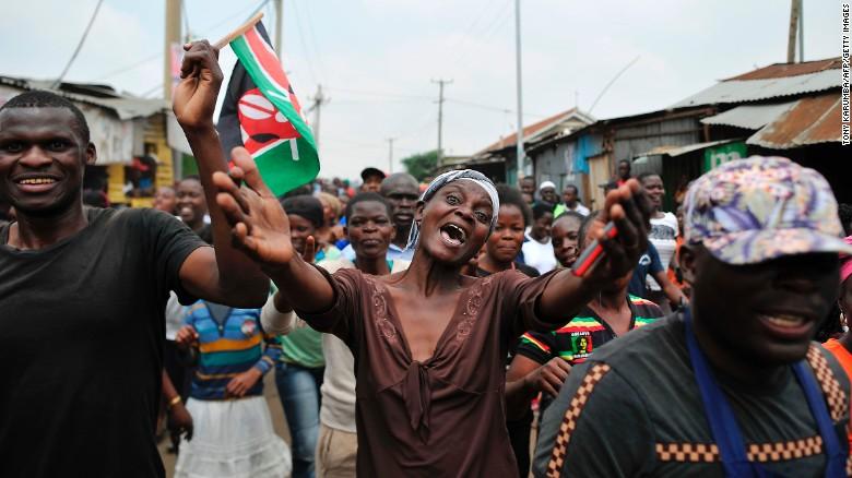 Supporters of Kenya's opposition leader Raila Odinga celebrate in the streets of Nairobi on Friday.