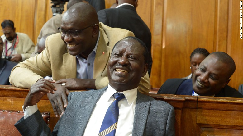 Kenya's opposition presidential candidate Raila Odinga (C) reacts to the Supreme Court ruling in Nairobi on Friday.