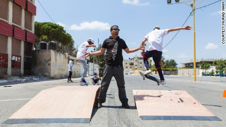 Children perform tricks on skateboards at the SkateQilya summer camp in the West Bank town of Qalqilya.
