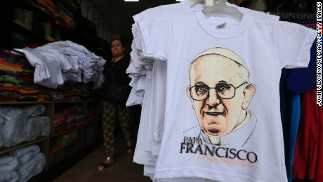 View of T-shirts with images of Pope Francis at a store downtown in Bogota, on August 10, 2017.  Pope Francis will make a special four-day visit to Colombia, from September 6-11, to add his weight to the process of reconciliation between the government and the FARC. / AFP PHOTO / John Vizcaino        (Photo credit should read JOHN VIZCAINO/AFP/Getty Images)