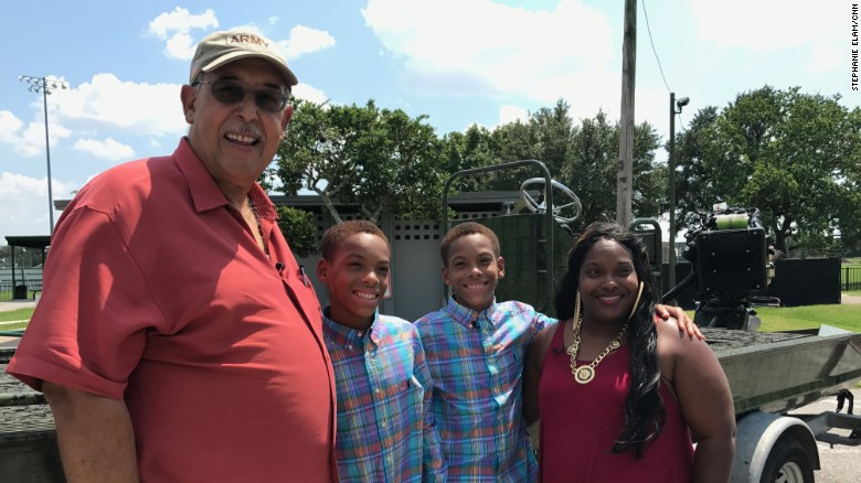 Retired Lt. Gen. Russel Honoré visits with Alexandra Wheeler and her sons, J'Mari and A'Mari.