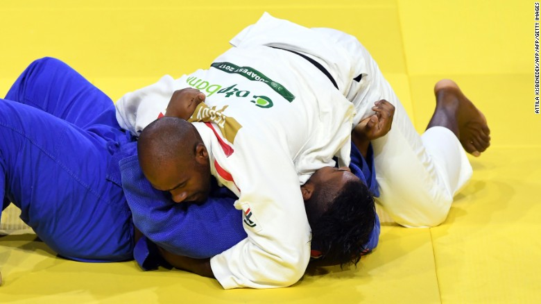 Teddy Riner pins Ecuador's Freddy Figueroa for 20 seconds to score ippon in their third-round match.