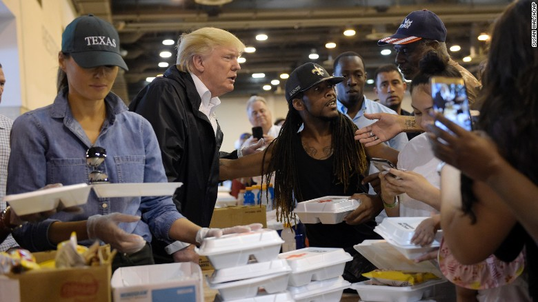 Trump visits with Harvey victims, serves food