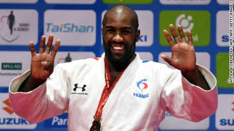 Gold medalist France's Teddy Riner celebrates on the podium of the mens +100kg category at the Judo World Championships in Budapest on September 1, 2017 during the medal ceremony.    / AFP PHOTO / ATTILA KISBENEDEK        (Photo credit should read ATTILA KISBENEDEK/AFP/Getty Images)