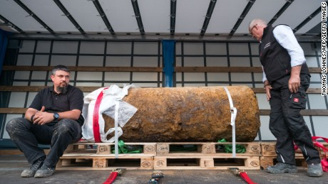 Dieter Schwetzler (R) and Rene Bennert (L) of the Explosive Ordnance Disposal Division pose next to the World War II bomb they defused in Frankfurt am Main, Germany, on September 03, 2017.  More than 60,000 people was evacuated from the center of Frankfurt on Sunday after a 1.4-ton World War II bomb (HC 4000 air mine) was discovered on a construction site close to the Goethe University Frankfurt compound last Tuesday.  / AFP PHOTO / Thomas Lohnes        (Photo credit should read THOMAS LOHNES/AFP/Getty Images)