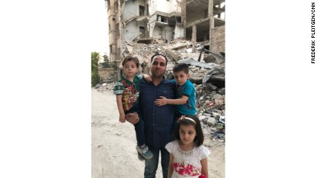 Mohammed Kheir Daqneesh with his three children.
