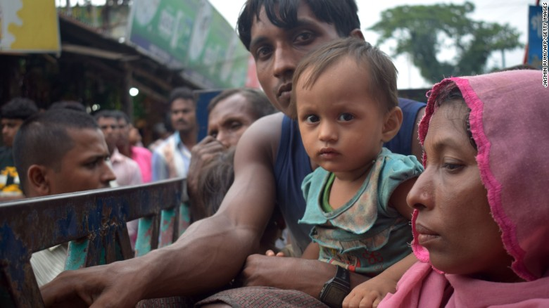 Rohingya refugees travel on an open-back truck near Kutupalong refugee camp in Ukhiya, Bangladesh, on September 3.