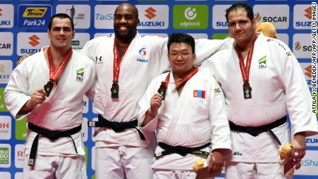 Medalists of the mens +100kg category, (L to R)  Brazil's David Moura of silver, France's Teddy Riner of the gold, Mongolia's Tuvshinbayar Naidan of the bronze and Brazil's Rafael Silva of the bronze celebrate on the podium during the medal ceremony at the World Judo Championships in Budapest on September 2, 2017.   / AFP PHOTO / ATTILA KISBENEDEK        (Photo credit should read ATTILA KISBENEDEK/AFP/Getty Images)