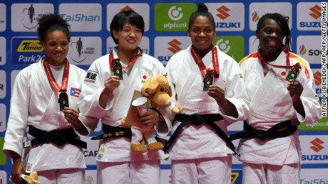 Women's middleweight judoka Maria Perez  (L) celebrates winning Puerto Rico's first ever silver medal.  Japan's Chizuru Arai, Colombia's Yuri Alvear and Spain's Maria Bernabeu join her on the podium.