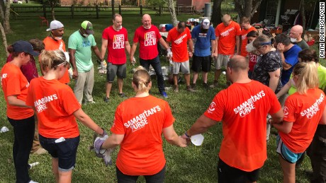 Samaritan's Purse volunteers and a local church group hold hands in prayer in Pearland, Texas.