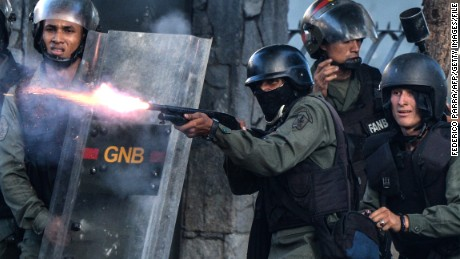 National Guard riot police and opposition demonstrators clash ensuing an anti-government protest in Caracas, on July 26, 2017. Venezuelans blocked off deserted streets Wednesday as a 48-hour opposition-led general strike aimed at thwarting embattled President Nicolas Maduro's controversial plans to rewrite the country's constitution got underway. / AFP PHOTO / FEDERICO PARRA        (Photo credit should read FEDERICO PARRA/AFP/Getty Images)