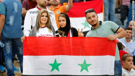 Supporters of Syria cheer for their team during the FIFA World Cup 2018 qualification football match between Iran and Syria at the Azadi Stadium in Tehran on September 5, 2017. / AFP PHOTO / ATTA KENARE        (Photo credit should read ATTA KENARE/AFP/Getty Images)