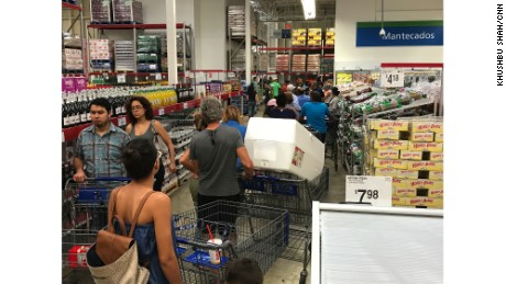 In San Juan, people stood on long lines Tuesday afternoon at a Sam's Club.