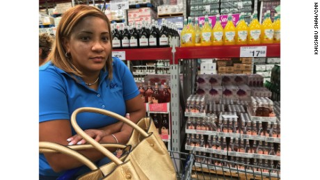 Joanna Martinez buys water at a Sam's Club in San Juan, Puerto Rico.