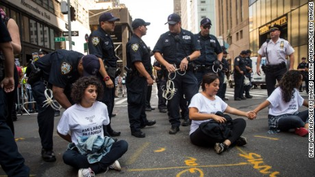 NEW YORK, NY - SEPTEMBER 5: Immigration activists protesting the Trump administration's decision on the Deferred Action for Childhood Arrivals are arrested by New York City Police (NYPD) officers as they sit in the street and block traffic on 5th Avenue near Trump Tower, September 5, 2017. On Tuesday, the Trump administration announced they will end the Deferred Action for Childhood Arrivals program, with a six month delay. The decision represents a blow to young undocumented immigrants (also known as 'dreamers') who were shielded from deportation under DACA. (Photo by Drew Angerer/Getty Images)