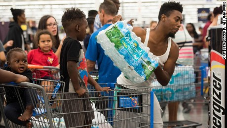 People stock up with water and other supplies at a Walmart in Fort Lauderdale, Florida, on Tuesday, September 5.