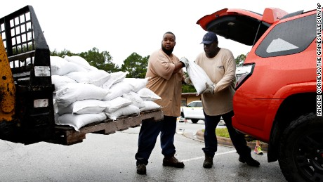 Aut Smith, 42, and Willie Young, 52, load up sandbags for the community at the City of Gainesville Public Works Department, on September 6, in Gainesville, Florida.