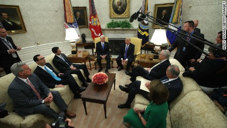 WASHINGTON, DC:  U.S. President Donald Trump (Top right) and Vice President Mike Pence (Top left) meet with: (clockwise from lower left) House Majority Leader Rep. Kevin McCarthy (R-CA), Treasury Secretary Steven Mnuchin, Speaker of the House Rep. Paul Ryan (R-WI), Senate Majority Leader Sen. Mitch McConnell (R-KY), Senate Minority Leader Sen. Chuck Schumer (D-NY) and House Minority Leader Rep. Nancy Pelosi (D-CA) in the Oval Office of the White House September 6, 2017 in Washington, DC. President Trump met with Congressional leaders to discuss bi-partisan issues.  (Alex Wong/Getty Images)