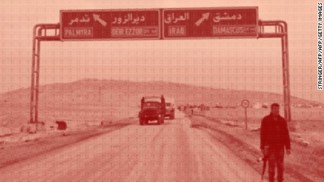A picture taken on March 2, 2017, shows a sign displaying the routes to Palmyra-Deir Ezzor and Damascus-Iraq as Syrian regime fighters advanced.