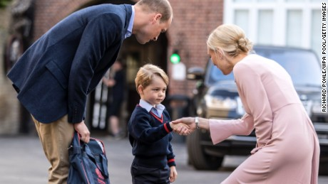 Prince George of Cambridge arrives for his first day of school with his father Prince William on September 7, 2017.