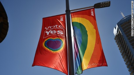 "A ""Vote Yes"" banner in support of same sex-marriage hangs on a street in Sydney on September 5, 2017.  Same-sex marriage advocates launched legal action in Australia's highest court on September 5, 2017 against a controversial government plan for a postal vote on the issue, calling it divisive and harmful. / AFP PHOTO / PETER PARKS        (Photo credit should read PETER PARKS/AFP/Getty Images)"