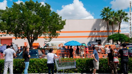 People wait in a line to purchase supplies outside a Home Depot store in Miami, Florida, as they prepare for Hurricane Irma, on September 7, 2017. Miami orders people living in popular beach areas to evacuate as Hurricane Irma closes in, amid fuel shortages and traffic bottlenecks that threaten to complicate a mass exodus from the Sunshine State. / AFP PHOTO / SAUL LOEB        (Photo credit should read SAUL LOEB/AFP/Getty Images)
