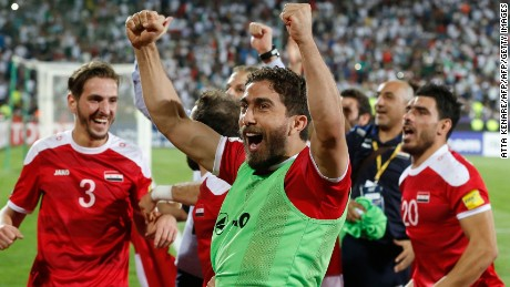Syria's players celebrate at the end of their FIFA World Cup 2018 qualification football match against Iran at the Azadi Stadium in Tehran on September 5, 2017. / AFP PHOTO / ATTA KENARE        (Photo credit should read ATTA KENARE/AFP/Getty Images)