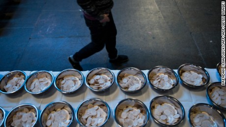 A person walks past Communion wafers during a youth rally at the Verizon Center January 25, 2013 in Washington, DC. The Archdiocese of Washington hosted the rally and mass prior to the annual March for Life which protests the 1973 Roe vs Wade US Supreme Court decision which legalized abortion. AFP PHOTO/Brendan SMIALOWSKI        (Photo credit should read BRENDAN SMIALOWSKI/AFP/Getty Images)