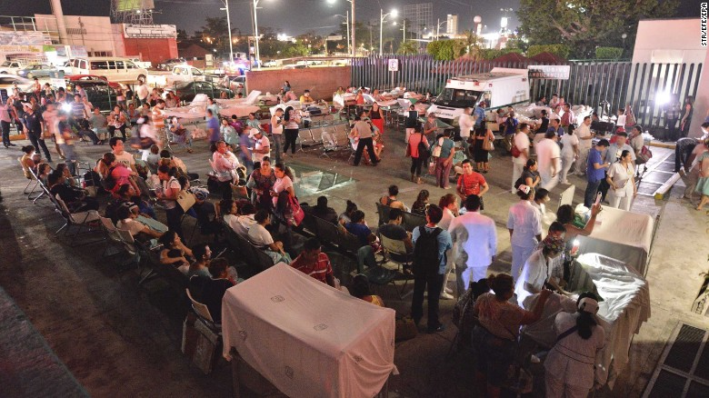 Patients and medical staff wait in the open after being evacuated from a hospital in Villahermosa, Mexico.