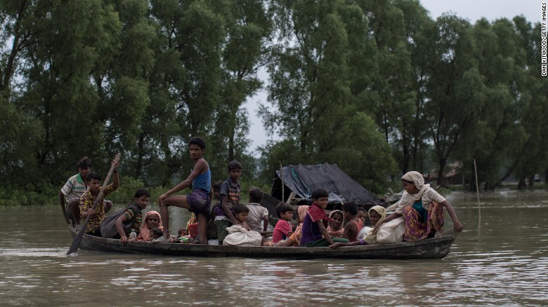 Rohingya Muslim refugees make their way into Bangladesh after crossing the border on September 7.