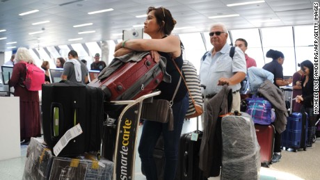 People flock to Fort Lauderdale International Airport on Thursday for evacuations out of Florida.