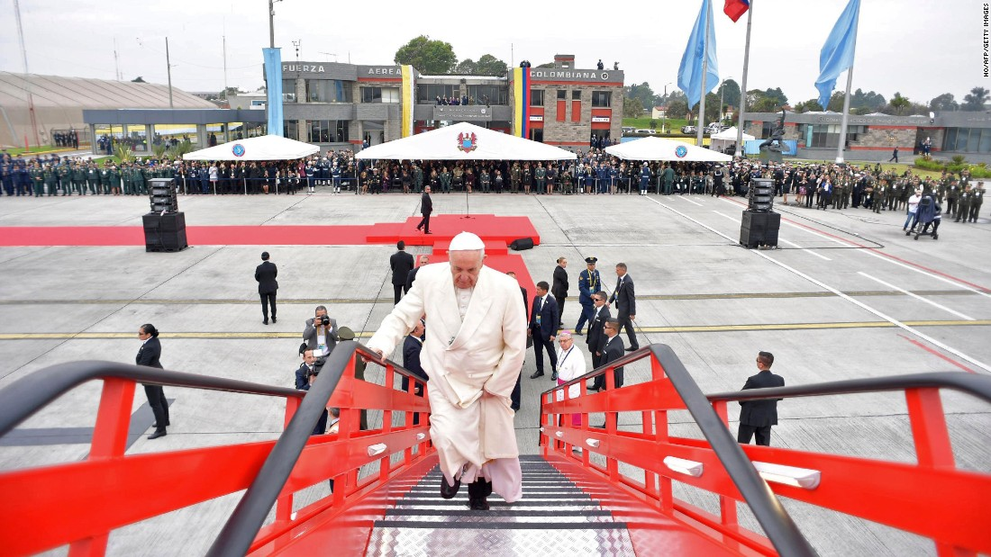 Pope Francis boards a plane at Bogota's Catam military airport as he heads to Villavicencio on September 8.