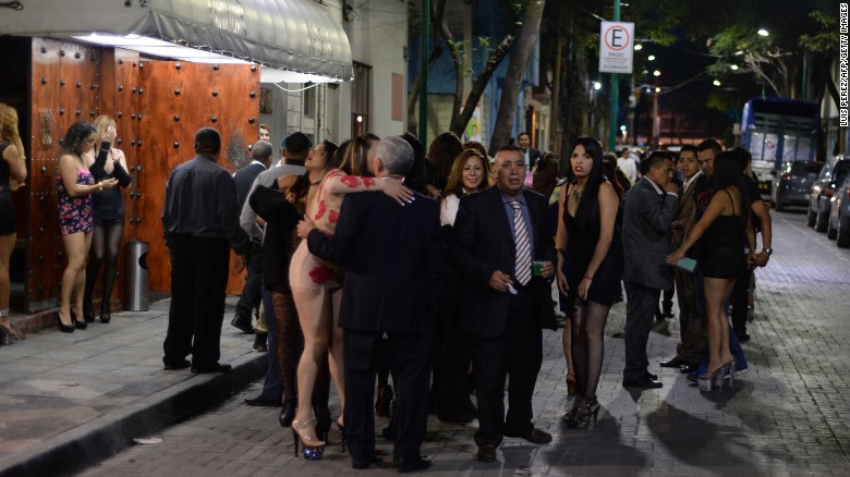 People gather outside a nightclub in downtown Mexico City following the quake.