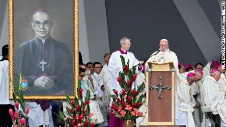 "Pope Francis (R) gives an open air mass in Villavicencio, Colombia, on September 8, 2017 during which he will beatify Colombian Bishop Jesus Jaramillo (painting on the left) and priest Petro Maria Ramirez.  Pope Francis urged Colombians to avoid seeking ""vengeance"" for the sufferings of their country's half-century civil conflict as they work towards a lasting peace. / AFP PHOTO / Luis ACOSTA        (Photo credit should read LUIS ACOSTA/AFP/Getty Images)"