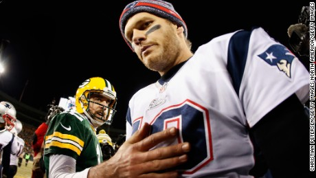 GREEN BAY, WI - NOVEMBER 30:  Quarterback Tom Brady #12 of the New England Patriots walks away from Aaron Rodgers #12 of the Green Bay Packers after shaking hands following the NFL game at Lambeau Field on November 30, 2014 in Green Bay, Wisconsin. The Packers defeated the Patriots 26-21.  (Photo by Christian Petersen/Getty Images)
