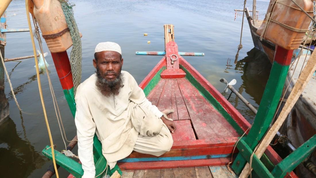 Fisherman Mohammad Rasheed, 41, sits aboard a boat in southeastern Karachi.