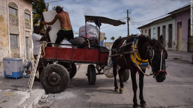 Cubans carry their belongings to a safer place on Friday ahead of the arrival of Hurricane Irma in the town of Caibarién.