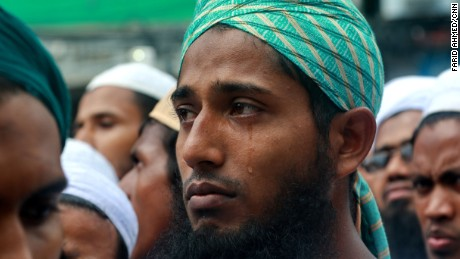 A protester cries as he listens to a preacher describing the plight of the Rohingya during a rally in Dhaka, Bangladesh on September 8, 2017.