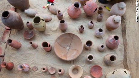 Workers are still piecing together parts of the pottery they have found so far.
