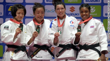 Medalists of the womens -57kg category, (L-R) Japan's Tsukasa Yoshida with the silver, Mongolia's Sumiya Dorjsuren with the gold, France's Helene Receveaux and Great Britain's Nekoda Smythe-Davis with the bronze celebrate on the podium during the medal ceremony at the World Judo Championships in Budapest on August 30, 2017.   / AFP PHOTO / ATTILA KISBENEDEK        (Photo credit should read ATTILA KISBENEDEK/AFP/Getty Images)
