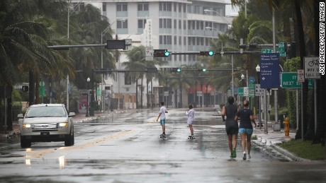 MIAMI BEACH, FL - SEPTEMBER 09: A nearly empty street is seen as outerbands of Hurricane Irma pass through on September 9, 2017 in Miami Beach, Florida. Florida is in the path of the Hurricane which may come ashore at  category 4.  (Photo by Joe Raedle/Getty Images)