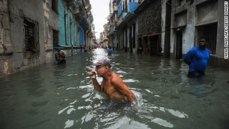 A Cuban man wades through a flooded street in Havana on September 10.
