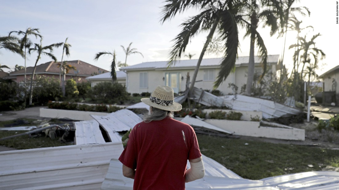 Rick Freedman checks damage to his neighbor's home in Marco Island on September 11.