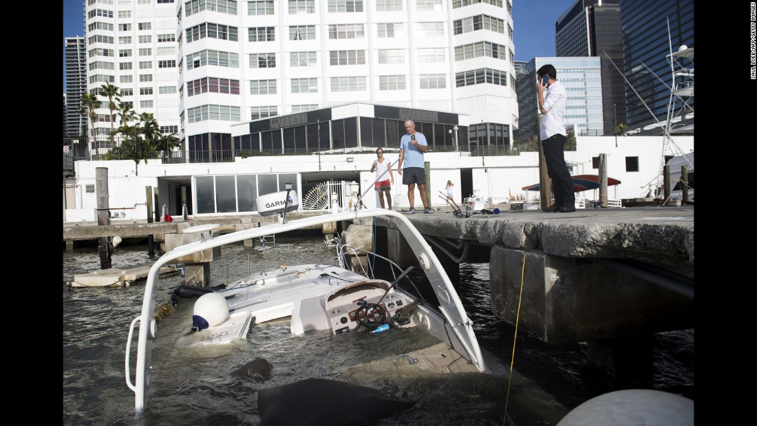 Boats are partially submerged in a marina in downtown Miami on September 11.