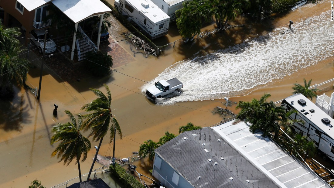 A truck drives through a flooded street in in Key Largo, Florida, on September 11.
