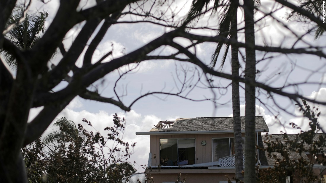 The roof of a home is damaged in Marco Island, Florida, on September 11.