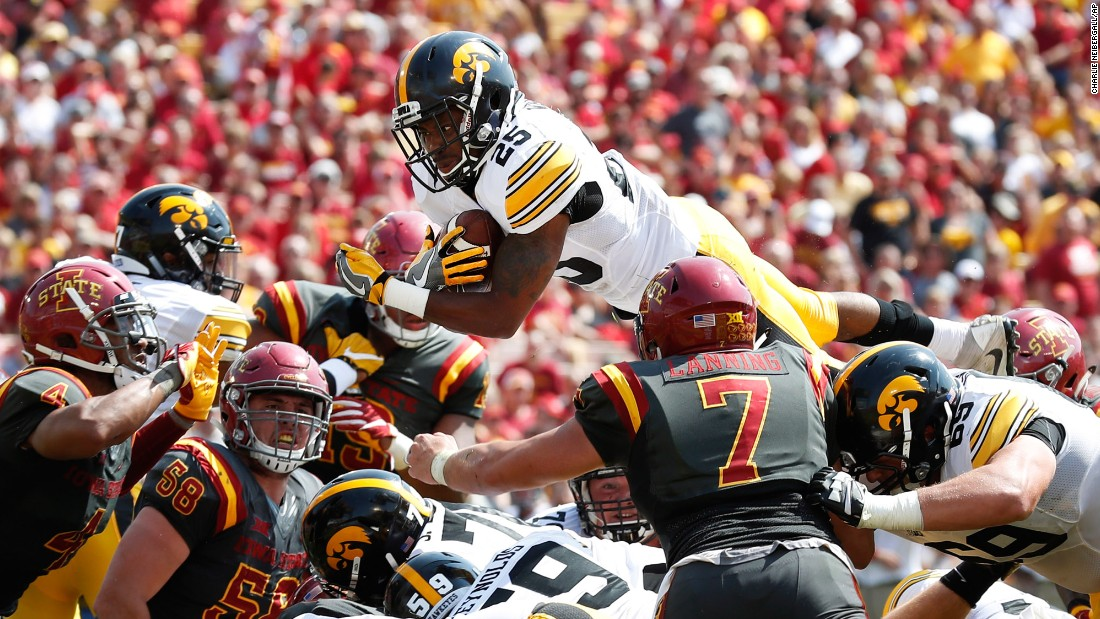 Iowa running back Akrum Wadley leaps for a 1-yard touchdown during the rivalry game at Iowa State on Saturday, September 9. Wadley scored two touchdowns and had nearly 200 yards of offense as Iowa won 44-41 in overtime.