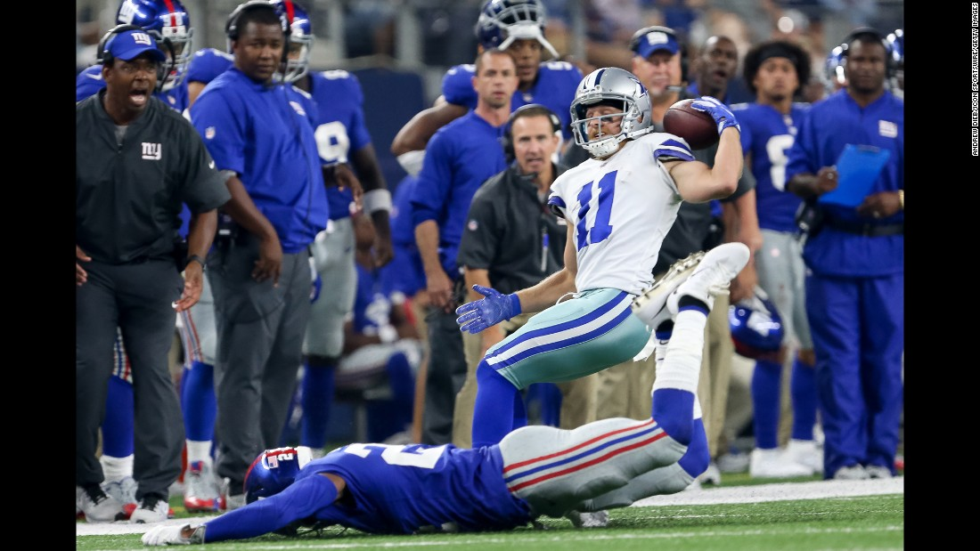 Dallas wide receiver Cole Beasley pins the ball onto his shoulder to make a catch against the New York Giants on Sunday, September 10.