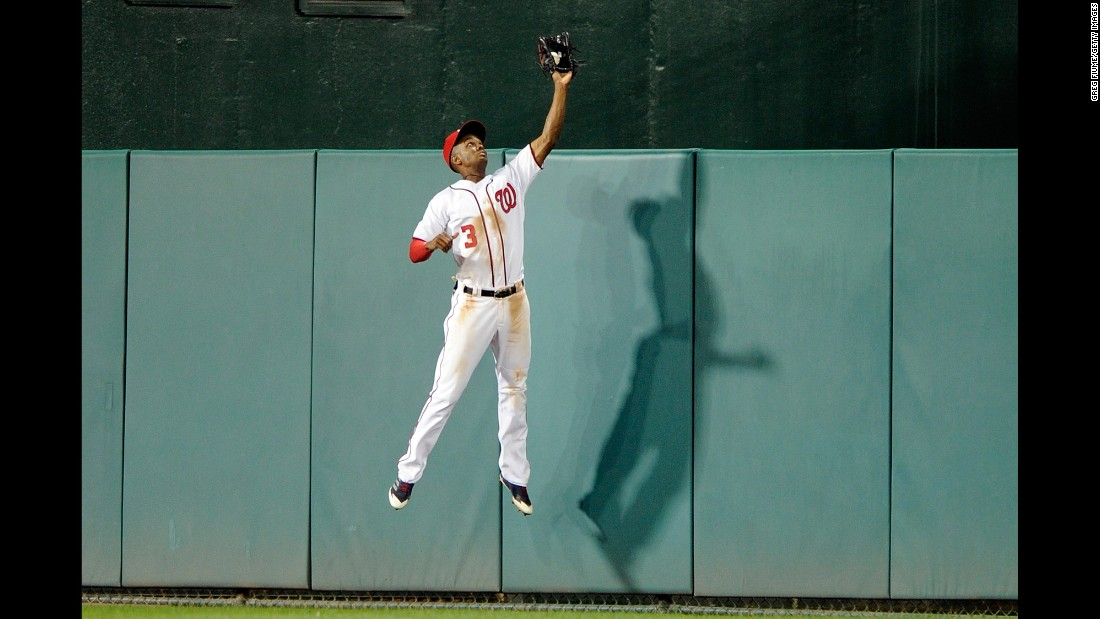 Washington outfielder Michael Taylor makes a catch at the wall during a home game against Philadelphia on Thursday, September 7.