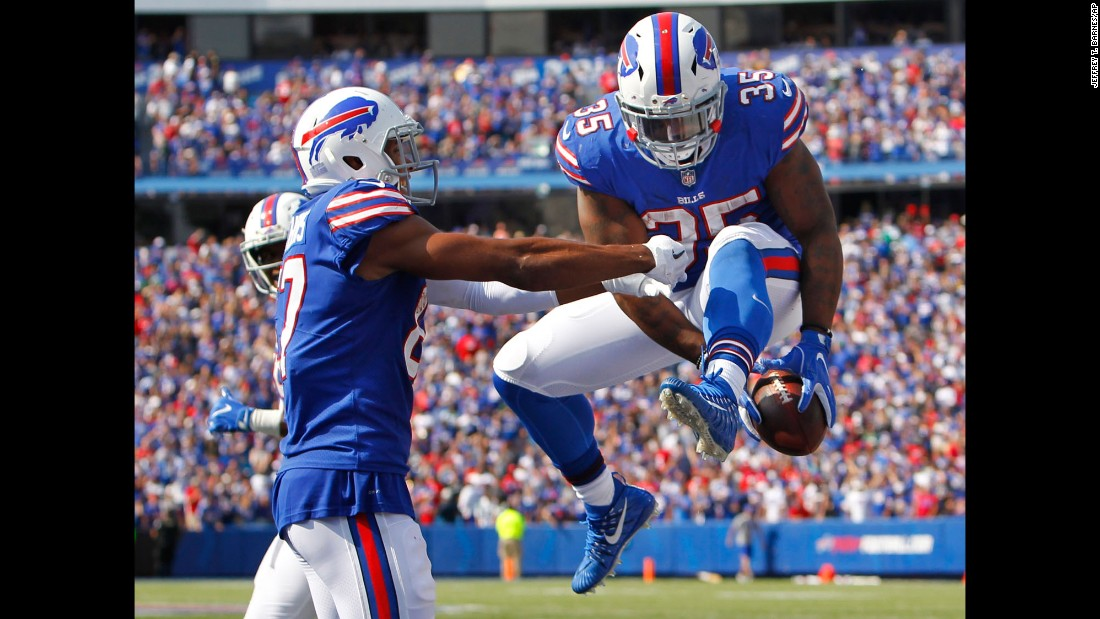 Buffalo fullback Mike Tolbert, right, celebrates with teammate Jordan Matthews after scoring a touchdown in the Bills' 21-12 victory over the New York Jets on Sunday, September 10.